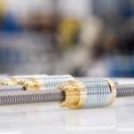 Anti-backlash nuts for lead screws