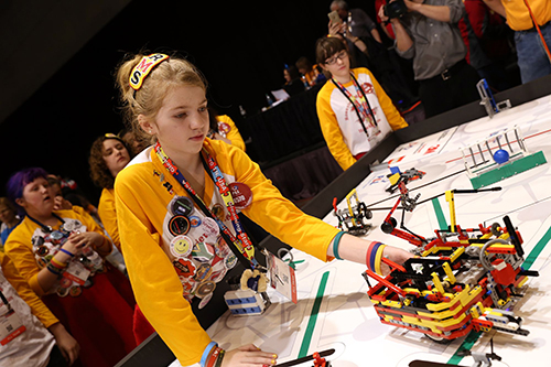 A student competes in the 2015 FIRST Championship