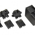 AC/DC power suppliers feature interchangeable input blades