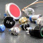 Anti-vandal pushbutton switches include illumination