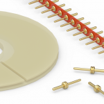 Low profile, removable carriers for male PCB pins and terminals